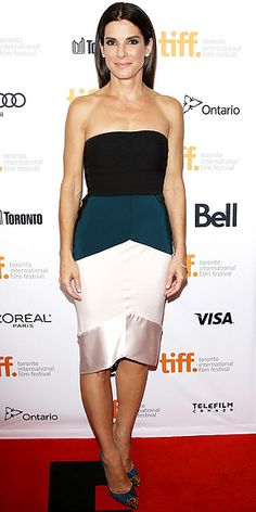 SANDRA BULLOCK The actress takes on fall's color-block trend in a strapless Narciso Rodriguez number, teamed with teal and gold-studded Christian Louboutin pumps at the Gravity premiere in Toronto.