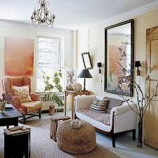 vibrant studio apartment ideas - Google Search mirror flanked by two sconces above a sofa