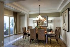 Crisp white wainscoting accents this elegant dining room. The Almeria plan, a new home built by Gehan Homes in the Palazzo at Estrella community. Goodyear, AZ.