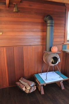 The cutest wood stove I've ever seen!  mini-humble-abode-8 on TinyHouseSwoon.com