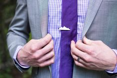 Unique wedding details - awesome mountain tie pin - mountain tie accessories  http://www.raynamcginnisphotography.com/sneak-peek-new-river-gorge-rock-climbing-wedding-felix-and-erica/  Purple wedding attire, mens wedding attire