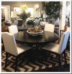 What's New Wednesday: Metal pedestal base dining table. Available through Heather Scott Home & Design.