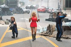 Eddie (Peter Dinklage) Lady Lisa (Ashley Benson) and Ludlow (Josh Gad) on the streets of Was http://www.thevideographyblog.com/share/pixels-3/?share_image=http%3A%2F%2Fd3l9bzfuzkm13y.cloudfront.net%2Fwp-content%2Fuploads%2F2015%2F08%2Fpixels-dom-PK-09_DF-09777__rv4-1310x874.jpg © 2015 CTMG, Inc. All Rights Reserved.