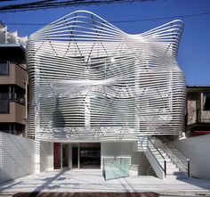 Amano design transforms Tokyo office building with contorted facade. Completed March Wonder what the 1925 facade, looked like. Architecture Du Japon, Architecture Design, Facade Design, House Design, Design Design, Building Facade, Building A House, Terrace Building, Famous Architects