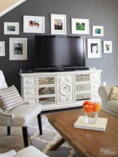 Prime Time Once an ugly 1970s brown dresser, the living room media center is a testament to what a little paint and a little creativity can do for a tired piece. A gallery of family photos showcased in white frames and mats makes the television less of a focal point.