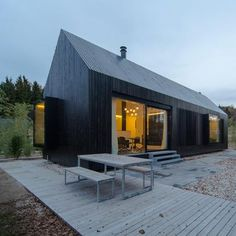 Format Elf Architekten's blackened timber cottages for a German resort