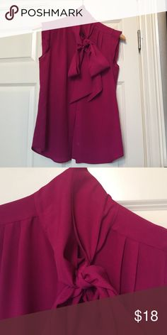 French Connection Pussy Bow Cap Sleeved Top This is a great Top!  I have had it altered to bring it in on sides, so this will fit more like a 2 or XS.  For this reason, the care/fabric tag is missing, but it has only been dry cleaned.  The color is a Fuchsia or Magenta. French Connection Tops Blouses