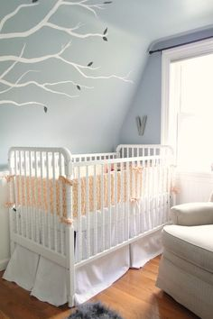 Light enough for the walls and the ceiling, Behr's Prelude is the perfect choice for this nursery.
