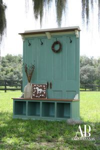 Twin doors and a book shelf on its side. Instant Mud Room cuteness.