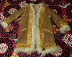 Reserved For Maria Vintage 1970s Hand Embroidered AFGHAN SHEARLING Real FUR Coat. 238.00, via Etsy.