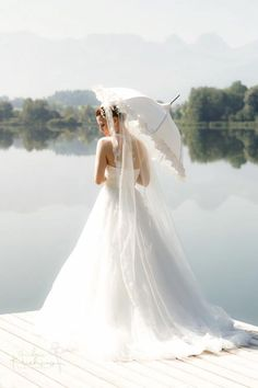 What a romantic photograph! Find umbrellas for rent and/or sale for your wedding, event or photo shoot at splendorforyourguests.com!  Splendor for Your Guests | Rental Company | Weddings | Events | Shawls | Blankets | Umbrellas | Parasols | Fans