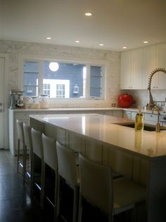 White cabinets, marble subway tile