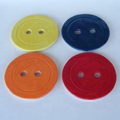 Colorful Painted Button Ceramic Pottery Serving Coasters. $48.00, via Etsy.