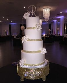 Gold and White wedding cake. Simple yet Beautiful!