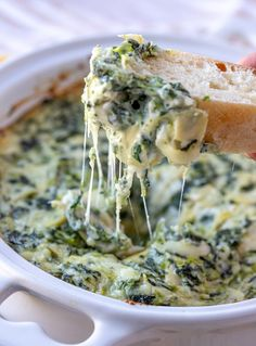 Cheesy Spinach and Artichoke Dip - Onion Rings & Things - - Cheesy spinach and artichoke dip is a favorite restaurant appetizer you can make at home easily in 30 minutes! Creamy, cheesy, and loaded with flavor, it's sure to be a crowd pleaser. Finger Food Appetizers, Appetizer Dips, Appetizer Recipes, Dip Recipes, Cooking Recipes, Cheesy Recipes, Potato Recipes, Vegetarian Recipes, Snack Recipes