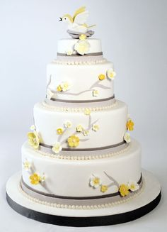 yellow and gray wedding cake. Also without the birds; I like the flowers and limb decorations