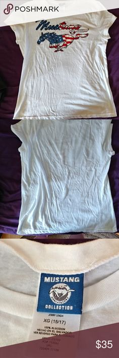 NWOT Mustang tee XL women's I tried this shirt on in the store, it fit, washed it and it shrunk just a bit much for me to wear. I have not worn it, hence the reason I listed nwot. Any questions feel free to ask! And as always prices are negotiable! Mustang Apparel  Tops Tees - Short Sleeve