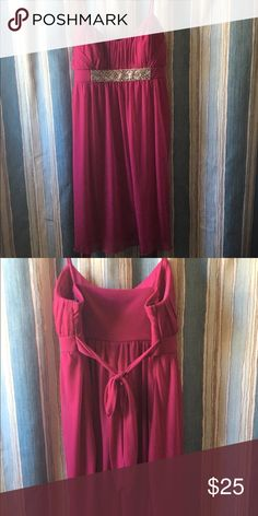 Like new formal dress! Great for homecoming! Pretty wine/fuchsia color with crystal detail on the front. Ties in the back. Hits about knee length. Please feel free to make an offer if you are interested! City Triangles Dresses Midi