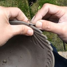 Piercing leaf edging on leather hard clay bowl.