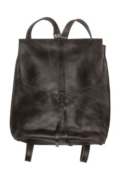 This locally-sourced Ethiopian leather backpack by Raven + Lily is a must-have everyday accessory. 100% leather; a small pocket on the inside and is finished with two small leather straps. Raven + Lil