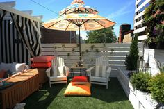 Patio - beautiful small urban backyard with vertical garden and pergola covered sitting area - cheerful space - love the umbrella | EAC Designs