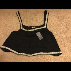 ‼️LOWEST PRICE‼️ Cute Flowy Crop Top  DONATING 4/1 NO OFFERS, LOWEST PRICE  This top is super cute just not fitting to my style. Not even sure why I bought it because I have yet to wear it but it's super light and would be perfect for the summertime! It's a navy blue color with off white detailing along the straps and bottom! Forever 21 Tops Crop Tops