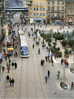 Transit Oriented Development. Tram and pedestrians share space in Strasbourg, France, where use of public transport has increased by 40 percent since 1990.