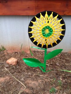 Hubcap Flowers. Inspired by another Pinterest pin.