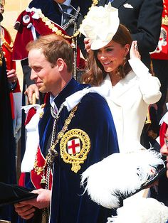Prince William leads the way for his beaming wife, Catherine, Duchess of Cambridge, following the annual Order of the Garter service Monday at St. George's Chapel inside London's Windsor Castle.