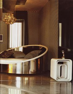 So new 70's I don't have this cool chair, but I have those white cubes in black & a repro phone like that in black.