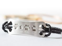 Platinum and leather bracelet with four actual cat pawprints and Name engravings. . . . #keepsake #petkeepsake #platinum #platinumjewelry #custommade #customized #personalized #customjewelry #cats #catlovers #catjewelry #bracelet #leatherjewelry #precious #memorykeeping #memories