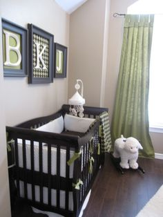 Love the  initials in the frames covered with ffabric that matches crib bedding/curtains.