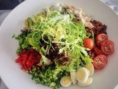 The Peninsula Cobb Salad: 'Pamora' chicken, cherry tomato, spring onion, bacon, avocado, quail egg, Roquefort cheese, sherry dressing