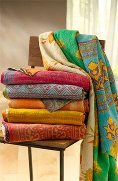 Handcrafted with reclaimed Indian saris. Proceeds go back to community. Love the colors!