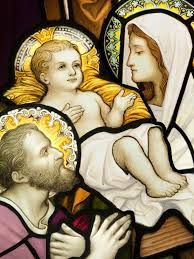 Stained glass painting of baby Jesus, Mary and Joseph