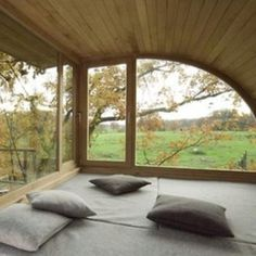 I want a bed positioned just like this... right at windows...  but home has to be somewhere warm to pull this off.