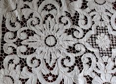 Made in Portugal, the all cutwork linen tablecloth has a variety of intricate whitework embroidery techniques. Features floral and scrolling leaf motifs. The napkins have cutwork and embroidery on the corner. | eBay!