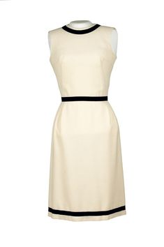 """Title: Sleeveless Dress Maker: A La Carte Medium: Wool Dimensions: 41 1/2"""" center back Description: A white wool sleeveless knee length dress with a black ribbon band around the waist, collar, and hem. Historical Note: This dress was worn by First Lady Jacqueline Kennedy at the opening of Treaty Room of the White House after it's redecoration on June 28, 1962."""