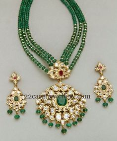 Three layered small round emeralds beads set with gold bits. Two step pachi work kundan pendant. Studded with large ruby, emerald stones. Bridal Jewelry, Beaded Jewelry, Beaded Necklace, Necklaces, Bead Jewellery, Pearl Necklace Designs, Ruby Beads, Gold Jewellery Design, Stud Earrings