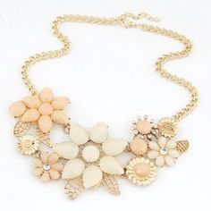 NWOT gold necklace with peach floral detailing NWOT gold necklace with peach floral detailing. Obviously not real gold, but gold in color. Last 3 images are of the actual necklace for sale. Boutique Jewelry Necklaces
