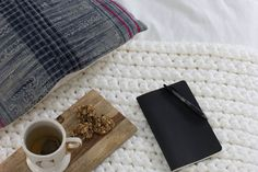 Pull out that crochet hook you've got stashed away because I'm about to show you how to make the easiest, coziest, most rewarding blanket…...