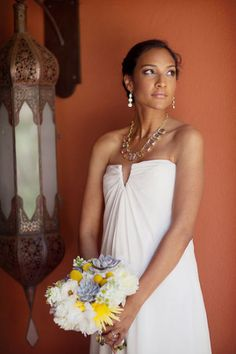 Nicole Miller - this was my wedding dress in 2011. I used a jeweled belt to pull in the waist.