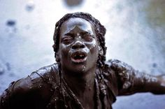 Tina Soriano 1998 - Haiti, the power of voodoo - Plaine du Nord - A Haitian pilgrim possessed by voodoo spirits bathes in the sacred mud pool.