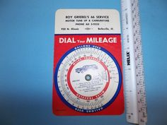 vintage advertising piece from Roy Griebels 66 Service station in Belleville Illinois.  This item is a mechanical wheel mileage calculator