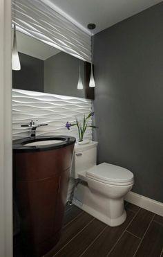 salle de bains moderne avec une peinture murale grise et un carrelage mural blanc effet 3D