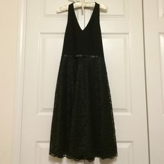 """❤️THE MARILYN MONROE HALTER LBD❤️ ❤️NWOT ❤️Stunning, unique halter dress ❤️Top is a dressy, smooth fabric material that forms perfectly in all the right areas. ❤️Black lace, A-line dress bottom ❤️Fully lined dress ❤️Hidden zipper and hook ❤️Length is 38"""" ❤️100% polyester ❤️Dry clean only ONLY reasonable offers will be considered ✳️Bundle option✳️ No low ball offers No trades Maggy London Dresses Midi"""