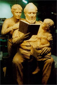"Bronze statue of Brigham Young and children on bench by Stan Watts  --  Brigham Young reading to his son and daughter from the Book of Mormon and the Bible. This monument is located at Brigham Young's grave site in the Brigham Young Family Cemetery, located  in Salt Lake City, Utah.  -  ""Two Books Shall Testify of Me""  -   LDS Sculpture by Mormon artist Stan Watts."