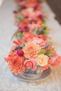Centrepiece Inspiration ~ What a clever idea using teacup and saucer filled with Dahlia's and Roses