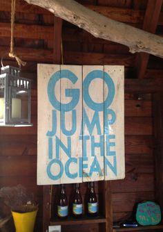 Go jump in the ocean wooden sign.