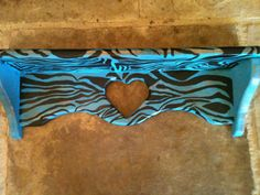 Hand painted teal shelf with zebra stripes by 2TEXASCHICKS on Etsy, $35.00
